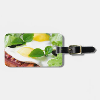Fried eggs with herbs, lettuce and  bacon luggage tag