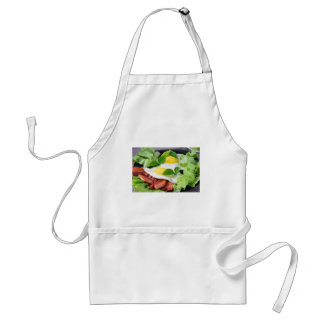 Fried eggs with herbs, lettuce and  bacon standard apron