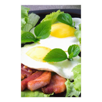 Fried eggs with herbs, lettuce and  bacon stationery design