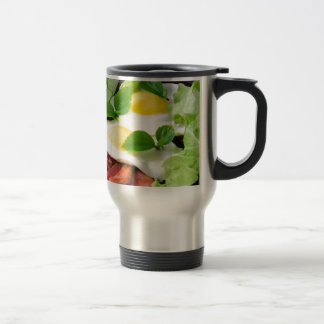 Fried eggs with herbs, lettuce and  bacon travel mug