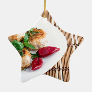 Fried meatballs of minced chicken on a stripe back ceramic star ornament