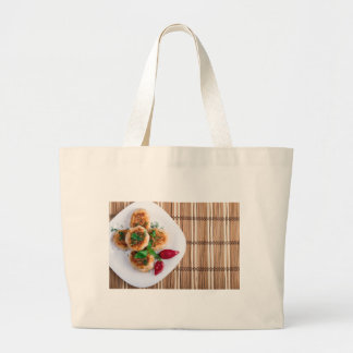 Fried meatballs of minced chicken with red pepper large tote bag