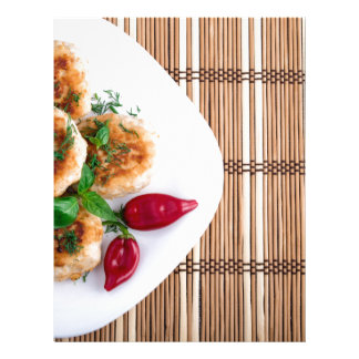 Fried meatballs of minced chicken with red pepper letterhead