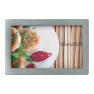 Fried meatballs of minced chicken with red pepper rectangular belt buckles