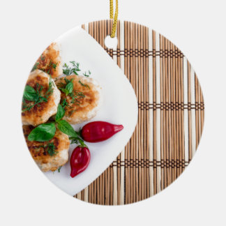 Fried meatballs of minced chicken with red pepper round ceramic ornament