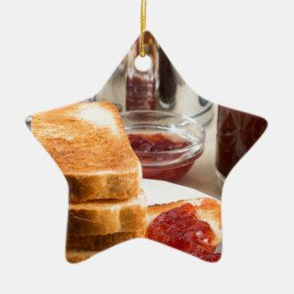 Fried toast with strawberry jam ceramic star ornament
