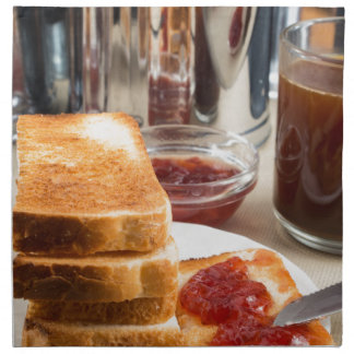 Fried toast with strawberry jam napkin