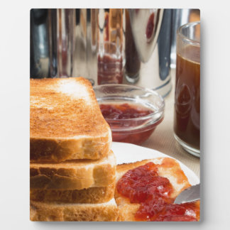 Fried toast with strawberry jam plaque