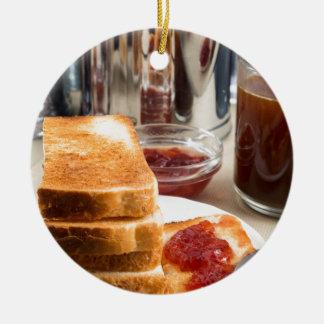 Fried toast with strawberry jam round ceramic ornament