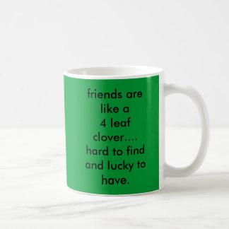 friends are like a 4 leaf clover....hard to fin... coffee mug