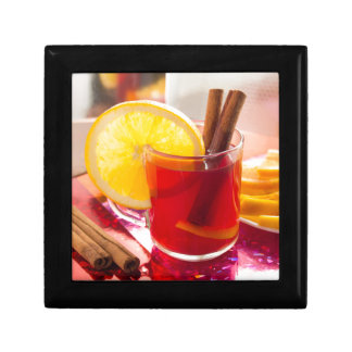 Fruit citrus tea with cinnamon and orange gift boxes