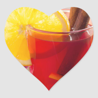 Fruit citrus tea with cinnamon and orange heart sticker