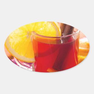 Fruit citrus tea with cinnamon and orange oval sticker