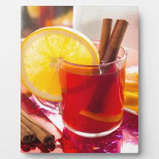 Fruit citrus tea with cinnamon and orange plaque