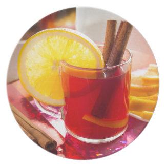 Fruit citrus tea with cinnamon and orange plate