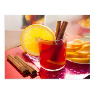 Fruit citrus tea with cinnamon and orange postcard