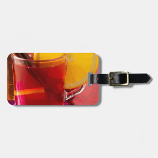 Fruit mulled wine with cinnamon and orange luggage tag