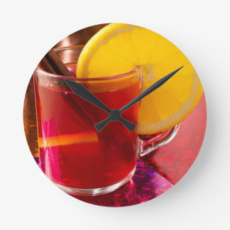 Fruit mulled wine with cinnamon and orange round clock
