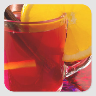 Fruit mulled wine with cinnamon and orange square sticker
