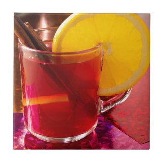Fruit mulled wine with cinnamon and orange tile