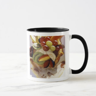 Fruit salad with ice cream. mug