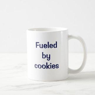 Fueled by cookies. classic white coffee mug