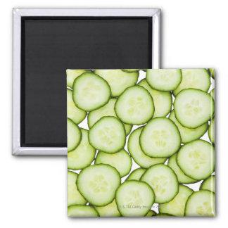 Full frame of sliced cucumber, on white square magnet