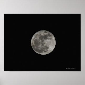 Full moon against night sky poster