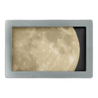 Full moon on black background belt buckles