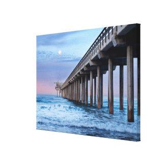 Full moon over pier, California Canvas Print