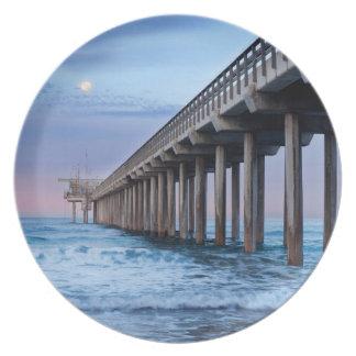 Full moon over pier, California Dinner Plates