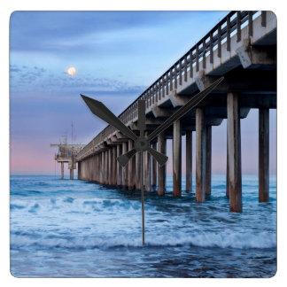 Full moon over pier, California Wall Clock