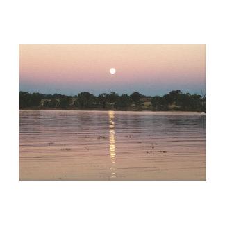 Full moon rising over Australian lake Canvas Print