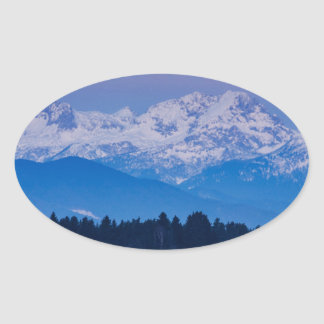Full Moon setting over the Julian Alps Oval Sticker