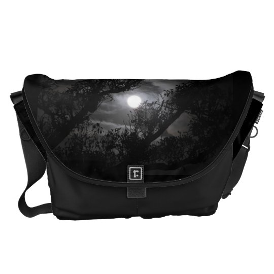 Full moon through the branches messenger bag