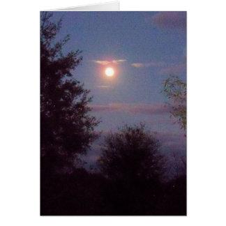 full Wolf moon rising  at dusk - on a blank card