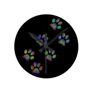 Fun animal paw prints. round clock