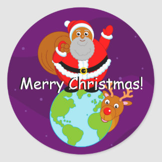 Fun black Santa Claus standing on the Earth, Classic Round Sticker