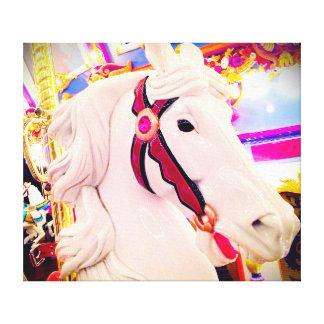 Fun carnival, white carousel horse close-up photo canvas print