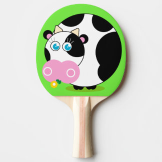 Fun cartoon black and white cow eating a flower, ping pong paddle