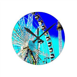 fun fair in amsterdam ferris wheel and high tower round clock