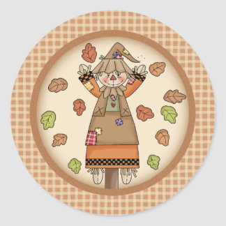 Fun Fall Scarecrow on Tan Plaid Pattern Background Round Sticker