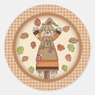 Fun Fall Scarecrow on Tan Plaid Pattern Background Round Stickers