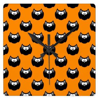 funny cartoon halloween owl over yellow backgroud clock