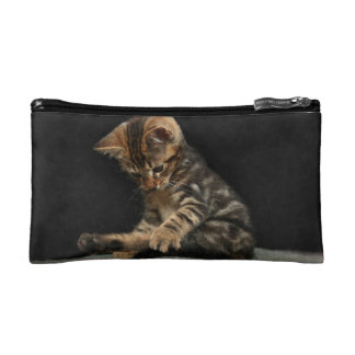 Funny cat playing with tail makeup bag