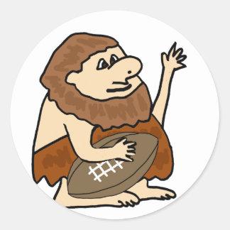 Funny Caveman with Football Cartoon Classic Round Sticker
