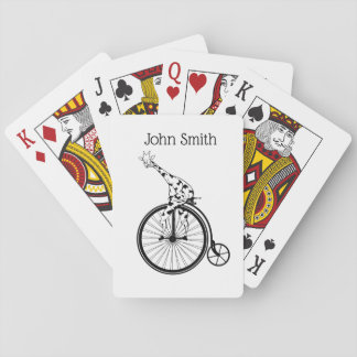 Funny giraffee riding a penny-farthing playing cards