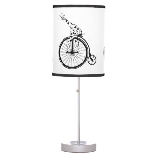 Funny giraffee riding a penny-farthing table lamp
