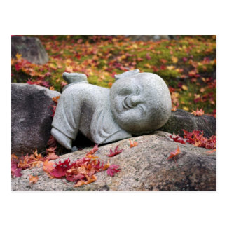 Funny Japanese monk statue with autumn leaves Postcard