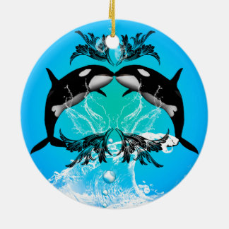 Funny orcas with water splash round ceramic ornament